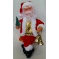 Музикална кукла - седящ Дядо Коледа със звънчета в ръка