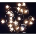 Коледни лампички звездички , светещи в жълто - на батерии